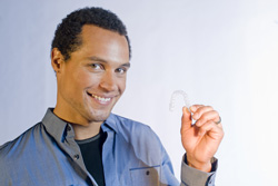 photo of man with invisalign appliance